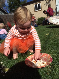 Carefree snacking at her first birthday party.