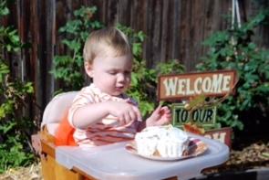 Eating a healthy banana smash cake on her first birthday.