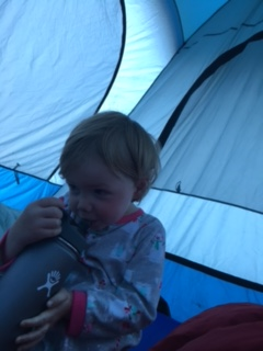 Chugging water in the tent as soon as she woke up.